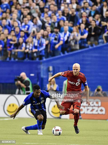 Patrice Bernier of the Montreal Impact and Michael Bradley of the Toronto FC chase the ball during leg one of the MLS Eastern Conference finals at...