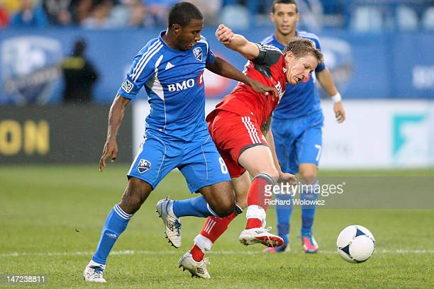 Patrice Bernier of the Montreal Impact battle for the ball with Terry Dunfield of the Toronto FC at the Saputo Stadium on June 27 2012 in Montreal...