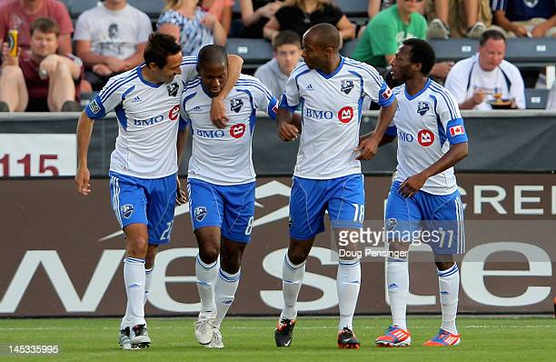 Patrice Bernier of the Montreal Impact celebrates his goal against the Colorado Rapids 14th minute with Davy Arnaud Collen Warner and Sanna Nyassi of...