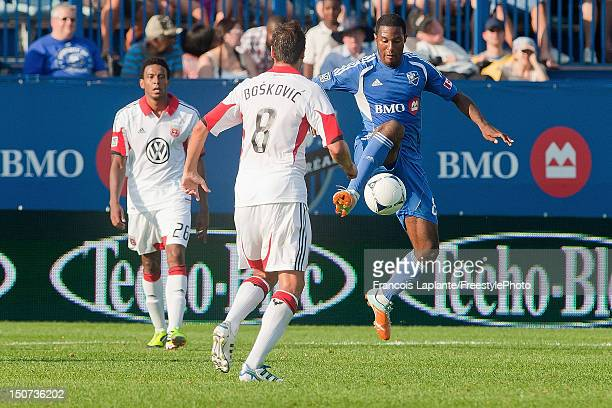 Patrice Bernier of the Montreal Impact controls the ball against Branko Boskovic of the DC United during the MLS match at Saputo Stadium on August 25...