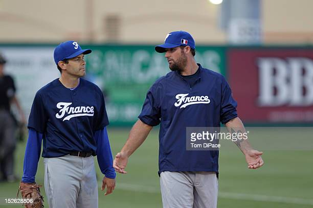 Patrice Birones of Team France talks with Team France pitching coach Eric Gagne before during game 2 of the Qualifying Round of the 2013 World...