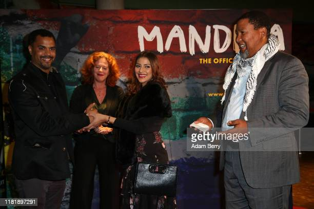 Patrice Bouédibéla Meike Ziegler Rabia Clarke and Nkosi Zwelivelile Mandela arrive for the opening of the exhibition Mandela The Official Exhibition...