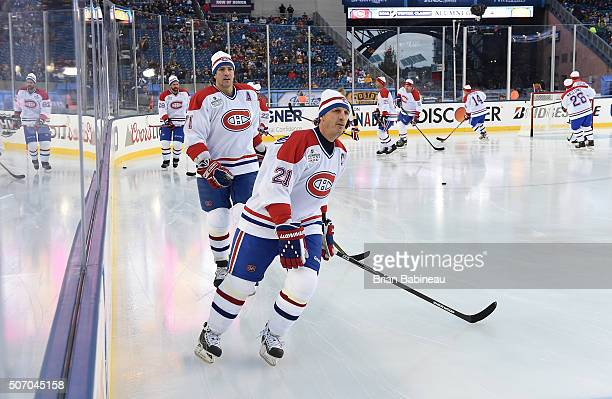 Patrice Brisebois and Guy Carbonneau of the Montreal Canadiens Alumni Team skate during warmup prior to the Alumni Game as part of the 2016...