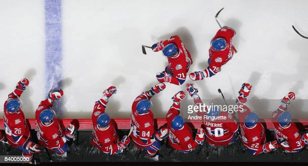 Patrice Brisebois of the Montreal Canadiens celebrates his first period goal against the Tampa Bay Lightning at the team bench at the Bell Centre...