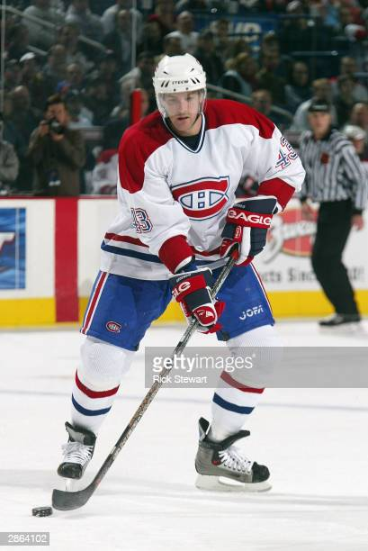 Patrice Brisebois of the Montreal Canadiens controls the puck near the blueline against the Buffalo Sabres on November 7 2003 at HSBC Arena in...