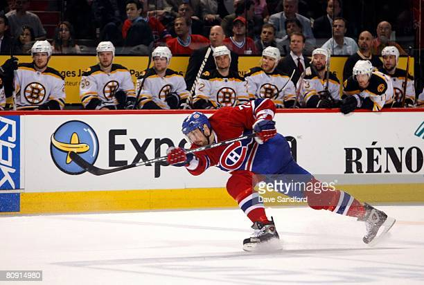 Patrice Brisebois of the Montreal Canadiens follows through on his shot from the point against the the Boston Bruins during game seven of the 2008...
