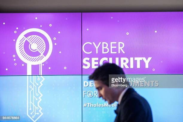 Patrice Caine chief executive officer of Thales SA speaks beside a digital key illustration during the Thales cyber security event in the Velizy...