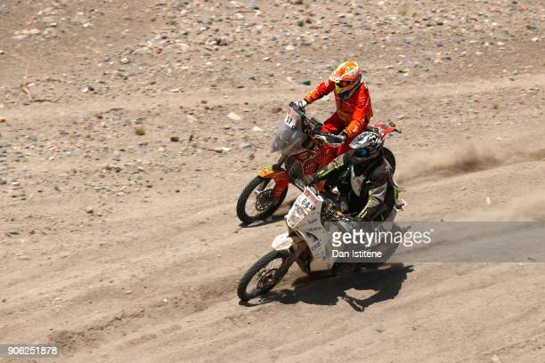 Patrice Carillon of France rides a KTM 450 Rally bike in the Classe 22 Marathon next to Philippe Cavelius of France and KTM rides a 450 Rally Replica...