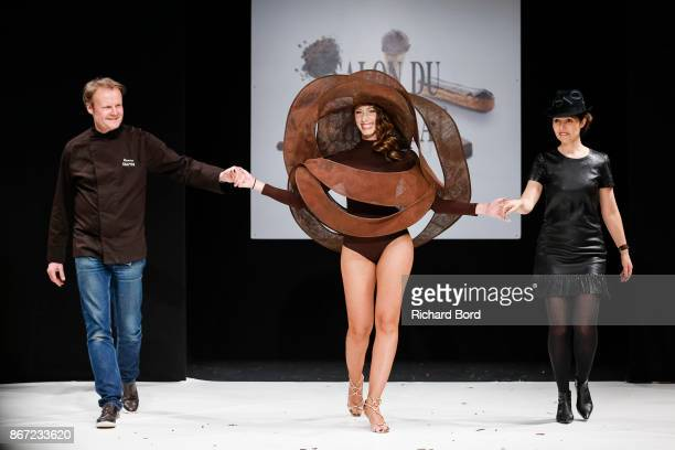 Patrice Chapon Silvia Notargiacomo and Laurence Bossion walk the runway during the Dress Chocolate show as part of Salon du Chocolat at Parc des...