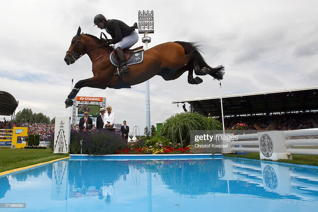Patrice Delaveau of France rideson Orient Express and won the thrid place during the Rolex Grand Prix jumping competition during the 2013 CHIO Aachen tournament on June 30, 2013 in Aachen, Germany.