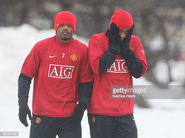 Patrice Evra and Anderson of Manchester United attend a First Team Training Session at Carrington Training Ground on January 15 2010 in Manchester...