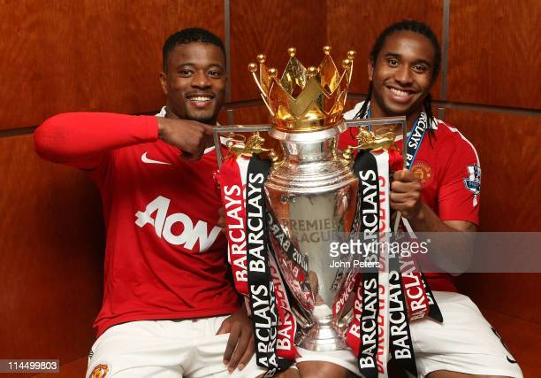 Patrice Evra and Anderson of Manchester United poses in the dressing room with the Barclays Premier League trophy after the Barclays Premier League...