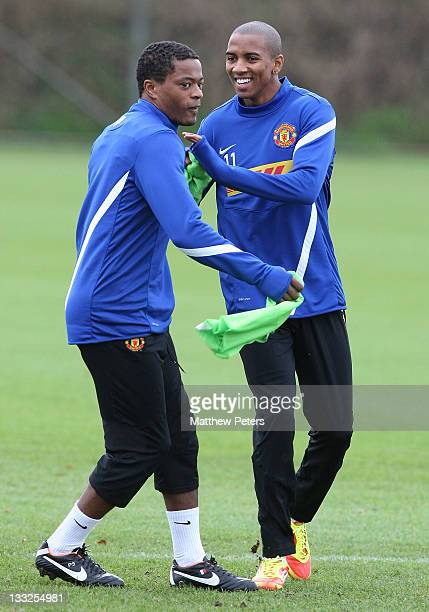 Patrice Evra and Ashley Young of Manchester United in action during a first team training session at Carrington Training Ground on November 18, 2011...