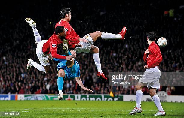 Patrice Evra and Cristiano Ronaldo of Manchester United compete with Deco of Barcelona during the Manchester United versus Barcelona Champions League...