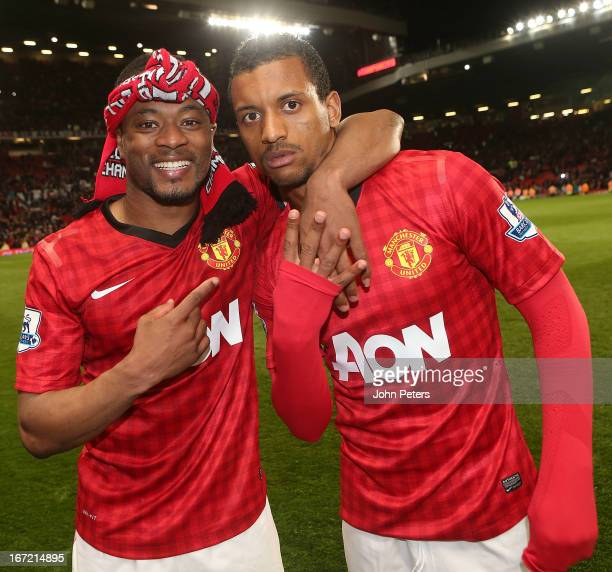 Patrice Evra and Nani of Manchester United celebrate on the pitch after the Barclays Premier League match between Manchester United and Aston Villa...