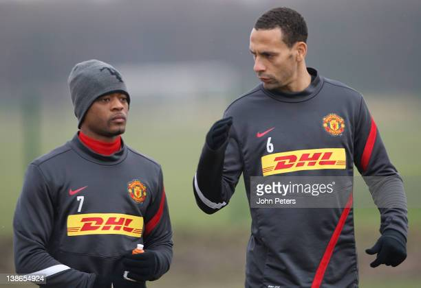 Patrice Evra and Rio Ferdinand of Manchester United in action during a first team training session at Carrington Training Ground on February 10, 2012...