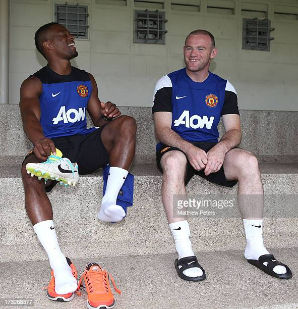 Patrice Evra and Wayne Rooney of Manchester United attend a first team training session at Royal Bangkok Sports Club as part of their preseason tour...