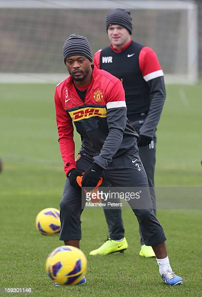 Patrice Evra and Wayne Rooney of Manchester United in action during a first team training session at Carrington Training Ground on January 11 2013 in...