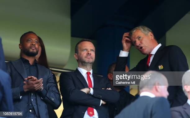 Patrice Evra, Ed Woodward, executive vice-chairman of Manchester United with David Gill before the Premier League match between Chelsea FC and...