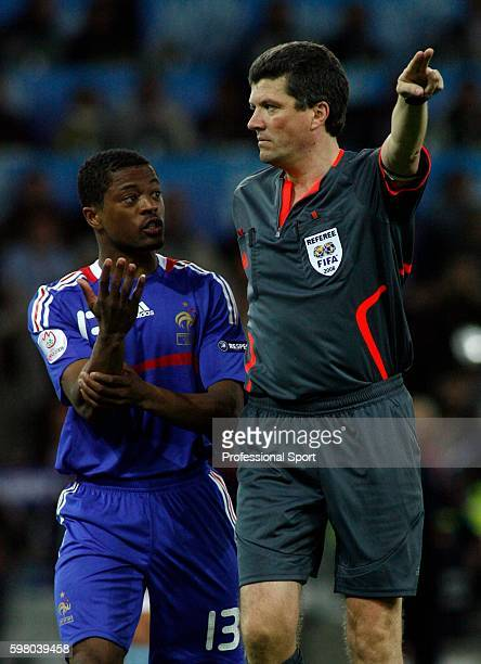 Patrice Evra of France claims handball to referee Herbert Fandel during the UEFA EURO 2008 Group C match between Netherlands and France at Stade de...