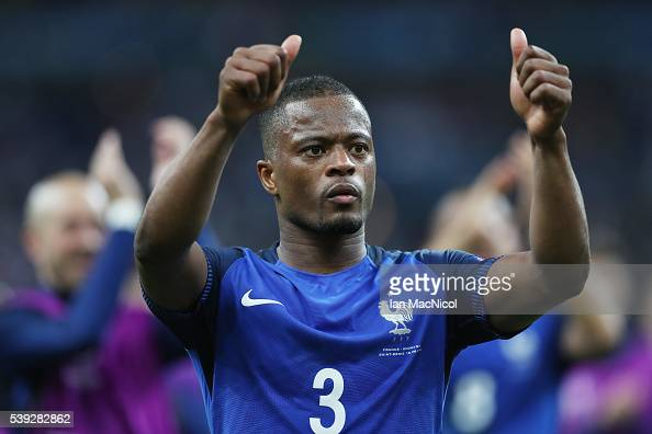 patrice evra of france gestures to the fans during the uefa euro 2016 photo d 39 actualit. Black Bedroom Furniture Sets. Home Design Ideas