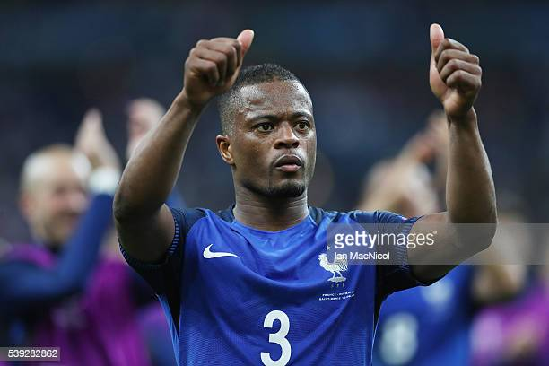 Patrice Evra of France gestures to the fans during the UEFA EURO 2016 Group A match between France and Romania at Stade de France on June 10 2016 in...