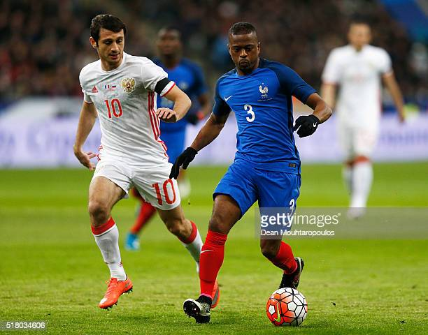 Patrice Evra of France gets past the tackle from Alan Dzagoev of Russia during the International Friendly match between France and Russia held at...