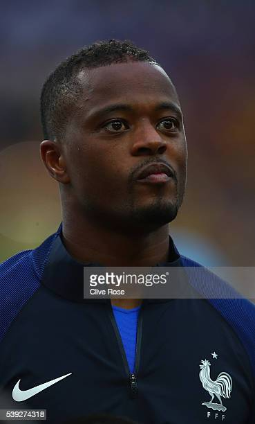 Patrice Evra of France lines up for the national anthem prior to the UEFA Euro 2016 Group A match between France and Romania at Stade de France on...