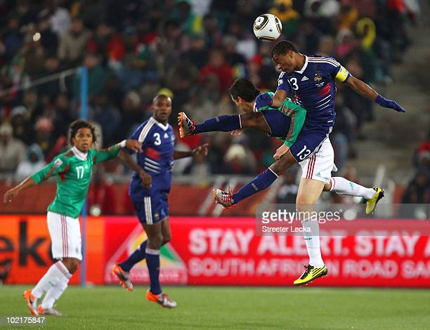 Patrice Evra of France wins the header under pressure from Guillermo Franco of Mexico during the 2010 FIFA World Cup South Africa Group A match...