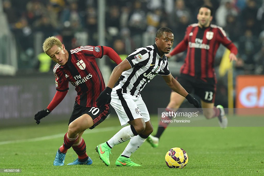Patrice Evra (R) of Juventus FC competes with Keisuke Honda of AC Milan during the Serie A match between Juventus FC and AC Milan at Juventus Arena on February 7, 2015 in Turin, Italy.