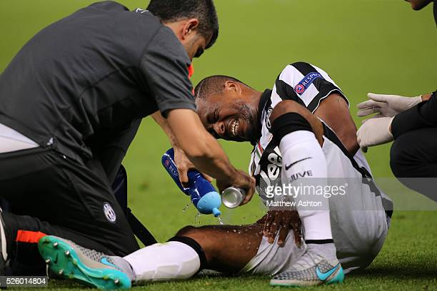 Patrice Evra of Juventus receives treatment on an injury to his right thigh