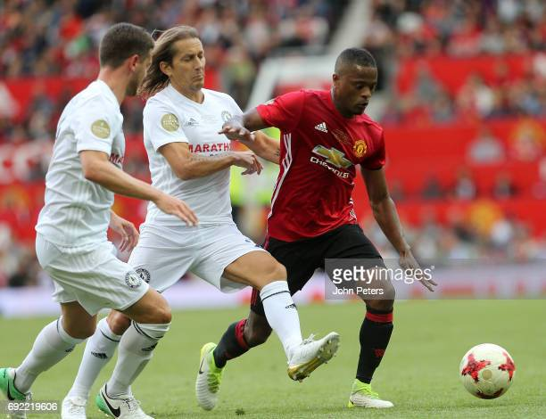 Patrice Evra of Manchester United '08 XI in action with Michel Salgado of Michael Carrick AllStars during the Michael Carrick Testimonial match...