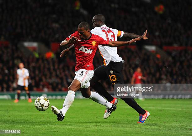 Patrice Evra of Manchester United battles with Dany Nounkeu of Galatasaray during the UEFA Champions League Group H match between Manchester United...