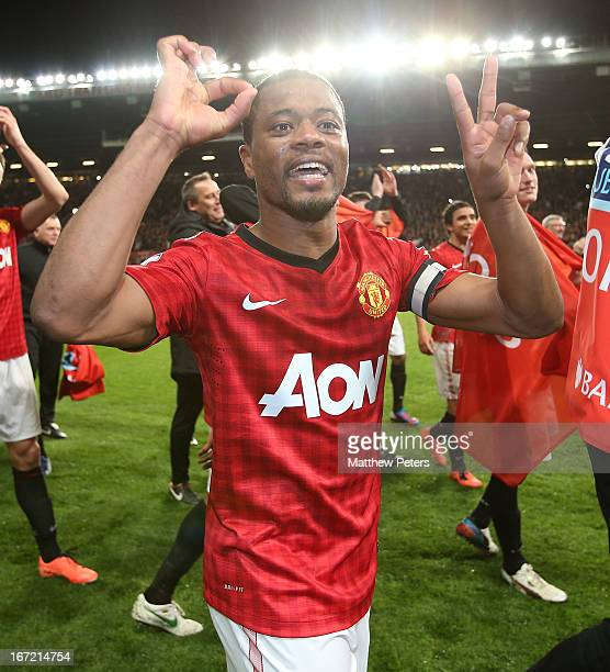 Patrice Evra of Manchester United celebrates at final whistle of the Barclays Premier League match between Manchester United and Aston Villa at Old...