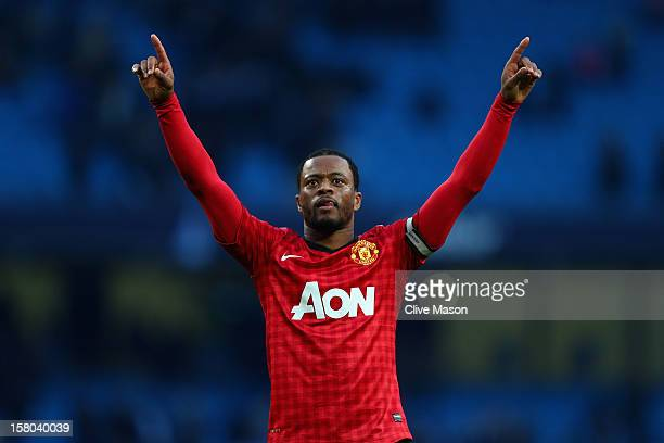 Patrice Evra of Manchester United celebrates at the end of the Barclays Premier League match between Manchester City and Manchester United at the...