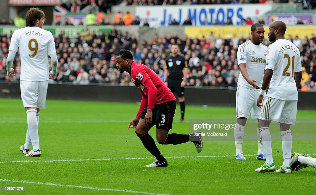 Patrice Evra of Manchester United celebrates his goal during the Barclays Premier League match between Swansea City and Manchester United at the Liberty Stadium on December 23, 2012 in Swansea, Wales.