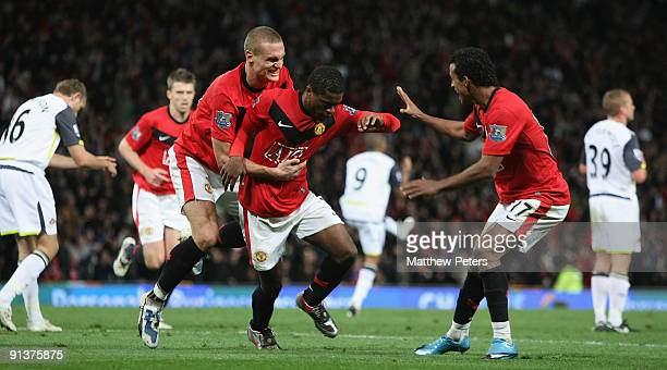 Patrice Evra of Manchester United celebrates his part in Anton Ferdinand of Sunderland scoring an own-goal during the Barclays Premier League match...