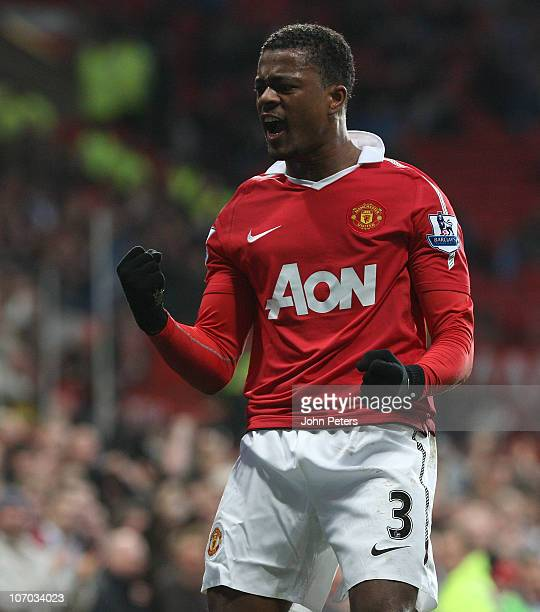 Patrice Evra of Manchester United celebrates scoring their first goal during the Barclays Premier League match between Manchester United and Wigan...