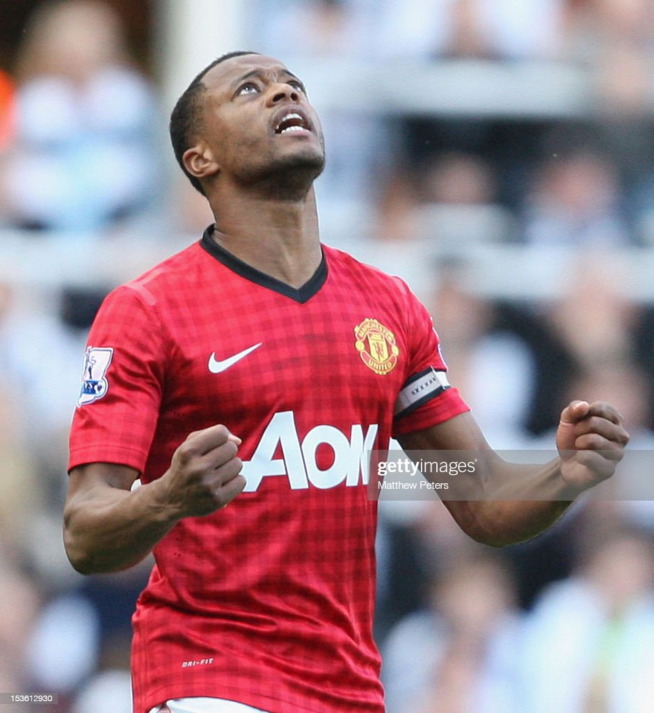 Patrice Evra of Manchester United celebrates scoring their second goal during the Barclays Premier League match between Newcastle United and Manchester United at Sports Direct Arena on October 7, 2012 in Newcastle upon Tyne, England.