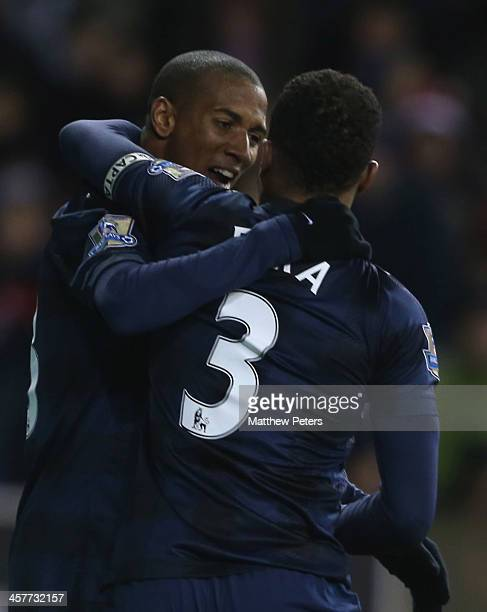 Patrice Evra of Manchester United celebrates scoring their second goal during the Capital One Cup Fifth Round match between Stoke City and Manchester...