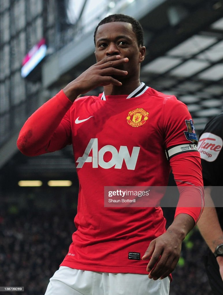 Patrice Evra of Manchester United celebrates victory after the Barclays Premier League match between Manchester United and Liverpool at Old Trafford on February 11, 2012 in Manchester, England.