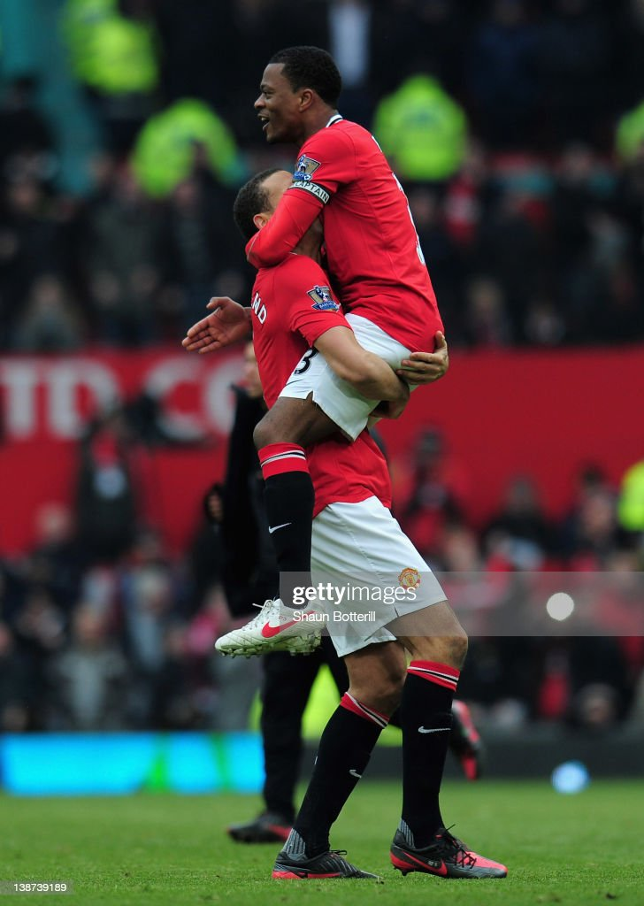 Patrice Evra of Manchester United celebrates victory with Rio Ferdinand after the Barclays Premier League match between Manchester United and Liverpool at Old Trafford on February 11, 2012 in Manchester, England.