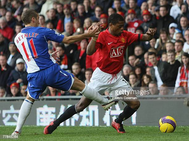 Patrice Evra of Manchester United clashes with David Bentley of Blackburn Rovers during the Barclays FA Premier League match between Manchester...