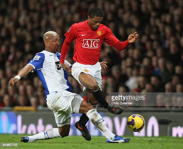 Patrice Evra of Manchester United clashes with ElHadji Diouf of Blackburn Rovers during the Barclays Premier League match between Manchester United...