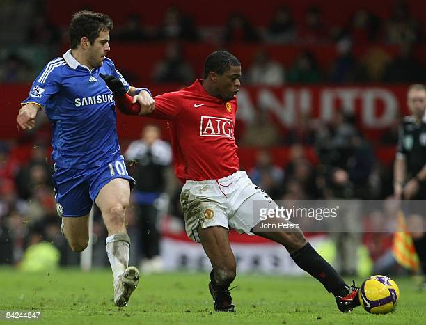 Patrice Evra of Manchester United clashes with Joe Cole of Chelsea during the Barclays Premier League match between Manchester United and Chelsea at...