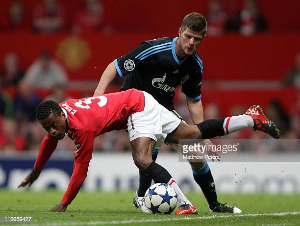 Patrice Evra of Manchester United clashes with KlaasJan Huntelaar of Schalke 04 during the UEFA Champions League SemiFinal second leg match between...
