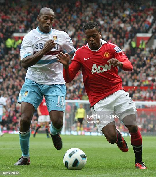 Patrice Evra of Manchester United clashes with Luis Boa Morte of West Ham United during the Barclays Premier League match between Manchester United...