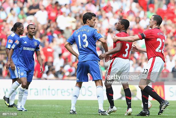 Patrice Evra of Manchester United clashes with Michael Ballack of Chelsea during the Community Shield match between Chelsea and Manchester United at...