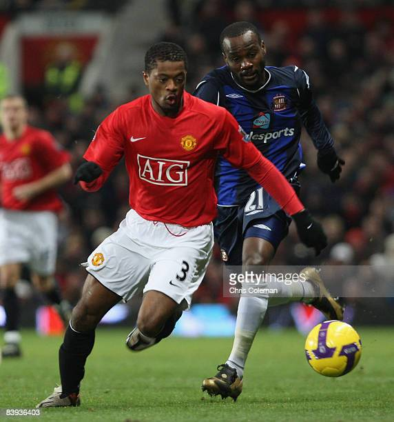 Patrice Evra of Manchester United clashes with Pascal Chimbonda of Sunderland during the Barclays Premier League match between Manchester United and...