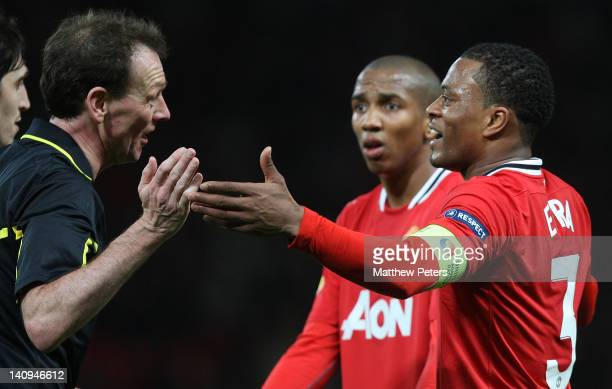Patrice Evra of Manchester United complains to referee Florian Meyer after the awarding of a freekick for Evra not wearing a boot from which a goal...